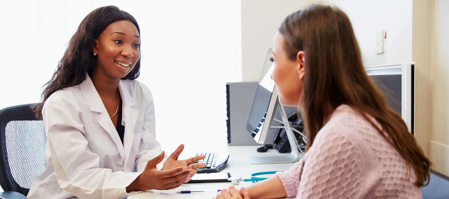 medical provider talking to patient