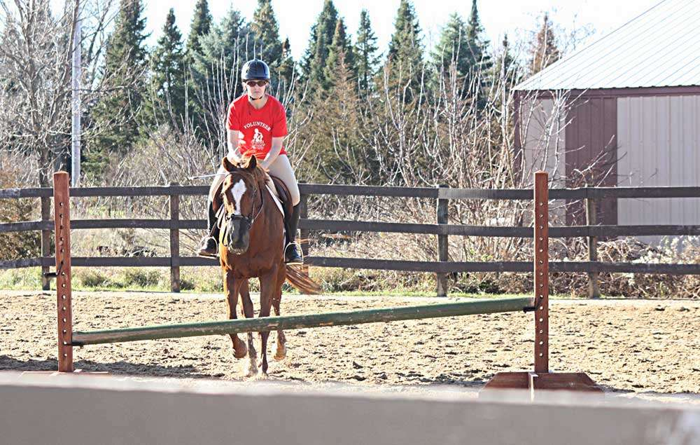 Lisa riding a horse