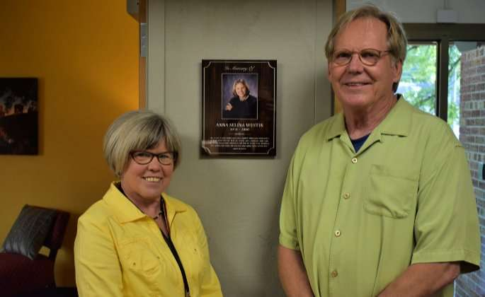 Kitty and Mark Westin with a Plaque for their Daughter, Anna