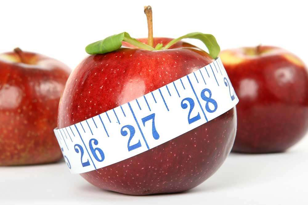 tape measure wrapped around apple