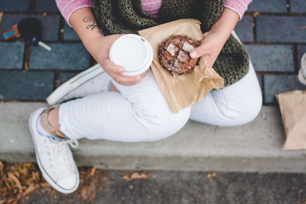 Girl holding coffee and scone