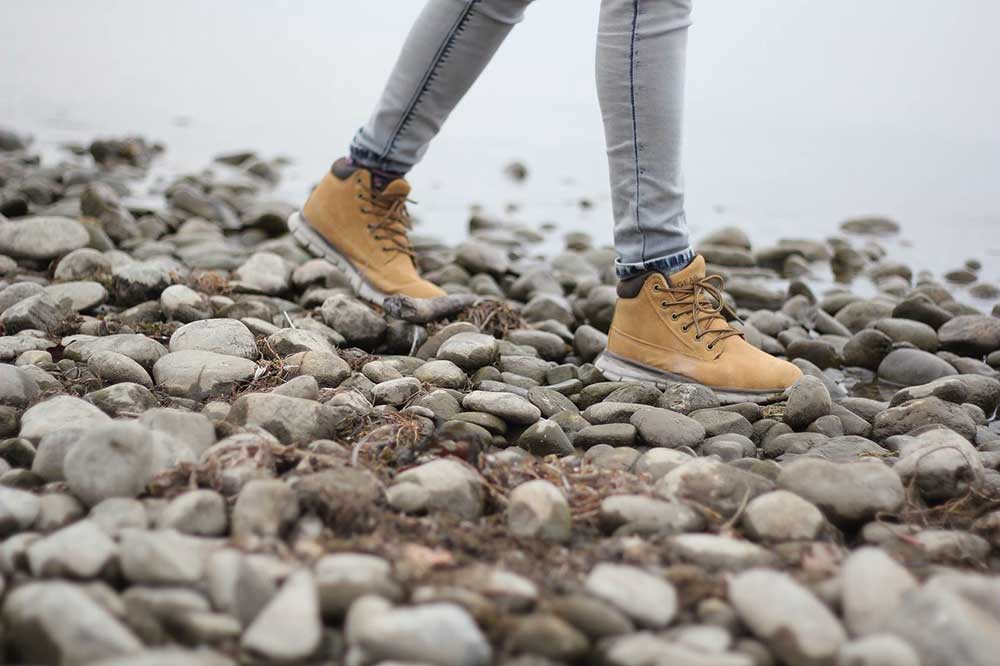Girl walking on rocks