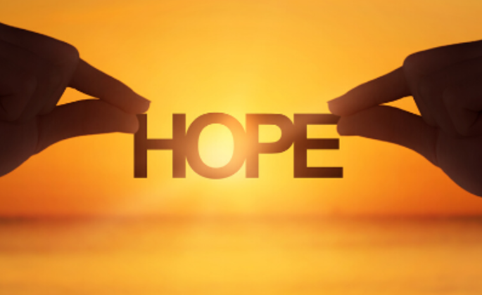 "A person holding the word ""hope"""